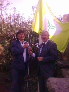 Peter & Francis Brennan of The Park Hotel Kenmare raise the E.U.Green Flower flag