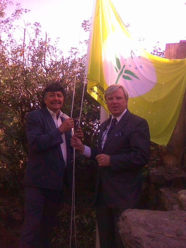 Peter & Frances Brennan raise the E.U.Green Flower Flag - for the first time ofer Glenribbeen.